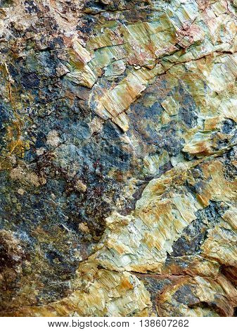 Geologic Rock, layers of mineral hues and colors.