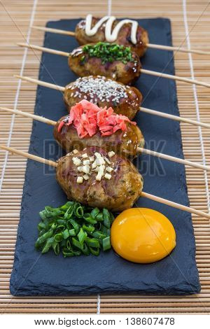 Tsukune Japanese chicken meatballs with scallimons and yolk