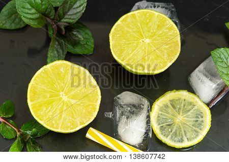 Cold Green Lime Fruit With Ice Cubes