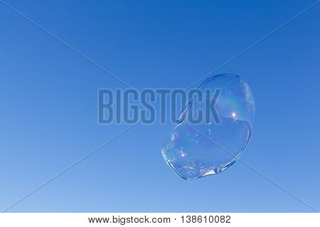 Image of a bubble with clear blue sky backdrop