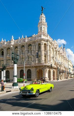 HAVANA,CUBA - JULY 14,2016 :  Street scene with classic convertible car next to the Great Theater of Havana