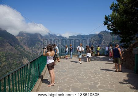 CURRAL DAS FREIRAS, MADEIRA, PORTUGAL - AUGUST 25: people at the beach, on March 13, 2016 in Curral das Freiras, Madeira Island, PORTUGAL