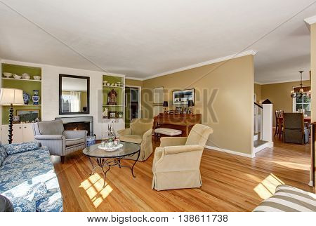 American Living Room Interior With Classic Sofa Set And Hardwood Floor.