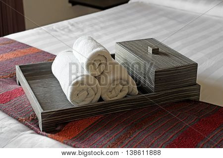 White Towels In Wooden Tray