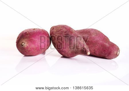 Yam Potatoes Close Up On White Background