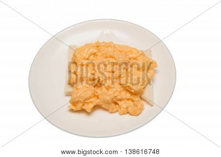 Scramble egg on white plate for breakfast