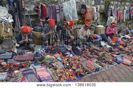 SAPA, VIETNAM, February 11, 2016 Dao women's group, highland Sapa, Vietnam, sitting embroidered brocade town center, Sapa, Vietnam