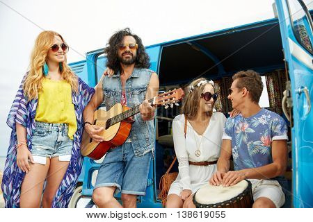 summer holidays, road trip, vacation, travel and people concept - happy young hippie friends with guitar and tom-tom drum playing music over minivan car