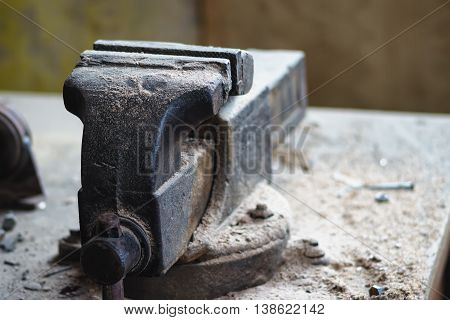 Old bench vise on a old woorking table