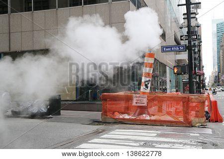 NEW YORK - JULY 9, 2016: Steaming pipe in Midtown Manhattan