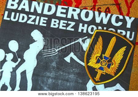 ILLUSTRATIVE EDITORIAL.Chevron of Ukrainian army.Background - Polish anti-ukrainian poster.Civil War in Ukraine.July 13 ,2016 in Kiev, Ukraine