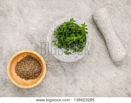Closeup Lemon Thyme Leaves From The Herb Garden In White Mortar And Pestle Set Up On Stone Table . T