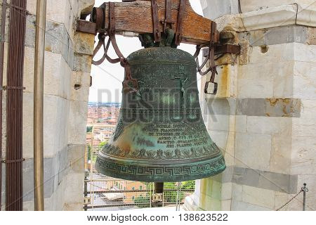 Ancient bell at the top of Leaning Tower in Pisa Italy.