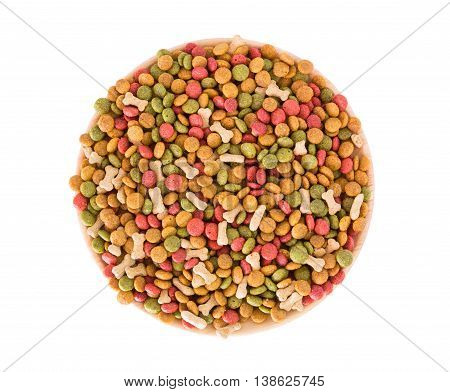 Dog food pellets on a white background.