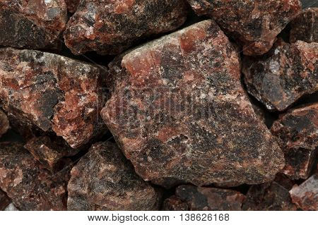 Raw Organic Himalayan Black Salt or Kala namak. Macro close up background texture. Top view.