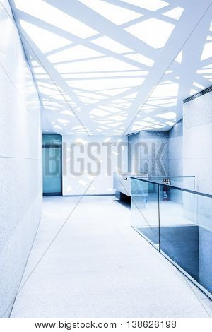 empty corridor with glass railing and abstract ceiling