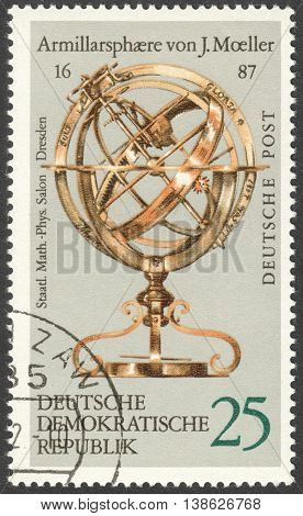 MOSCOW RUSSIA - CIRCA FEBRUARY 2016: a post stamp printed in DDR shows armillary sphere by J. Moeller 1687 the series