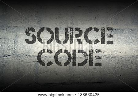 source code stencil print on the grunge white brick wall