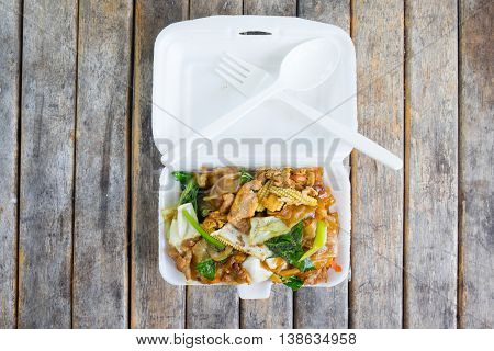 Stir-fried Noodles in Sweet Soy Sauce with Pork (Pad See-Ew) in foam box