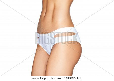 Beautiful sporty female stomach muscular body white swimsuit abdominals