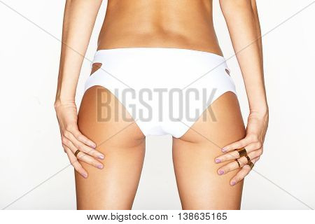 Beautiful female body. sexy ass in white swimming pants. isolated on white background