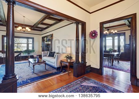 Open Floor Plan Of Living Room And Dining Room In Old Style House.