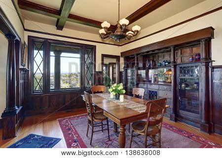 Antique Style Dining Room Interior With Fresh Flowers On The Table.