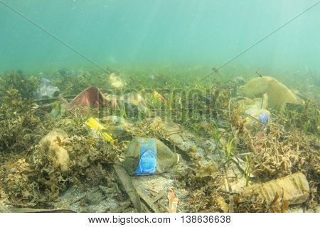 Plastic trash bags and bottles pollution in ocean