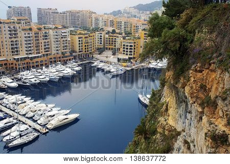 Cliff of Monaco, luxury yachts and elite apartments in the Port de Fontvieille, Monaco