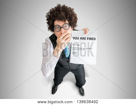 Disappointed Man Is Showing Letter With You Are Fired Message.