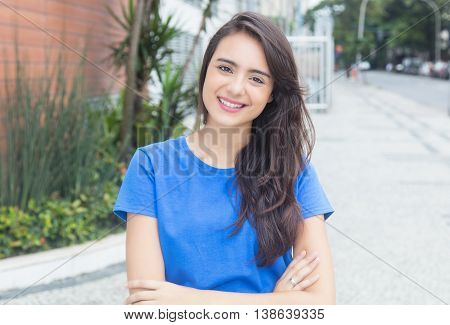 Laughing caucasian woman with blue in city in the summer