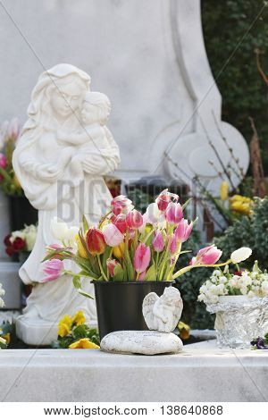 Monument of ancient angel on cemetery.