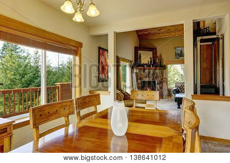 View Of Wooden Table Set In The Dining Room With Marble Tile Floor.