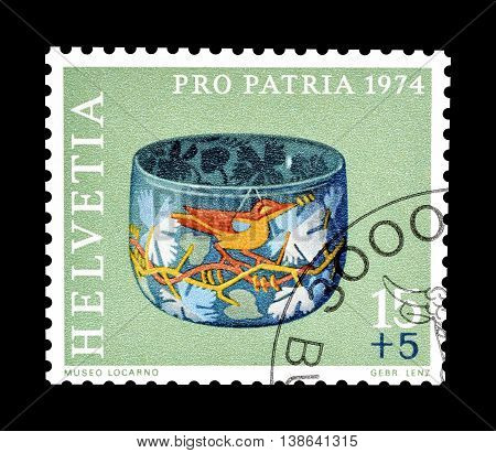 SWITZERLAND - CIRCA 1974 : Cancelled postage stamp printed by Switzerland, that shows Glass jar.