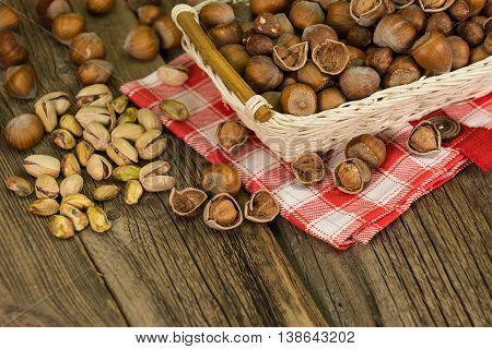 Hazelnuts in small wicker basket nut mix selective focus