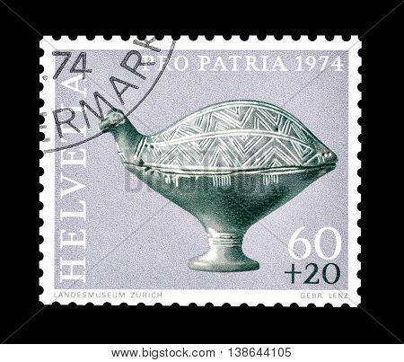 SWITZERLAND - CIRCA 1974 : Cancelled postage stamp printed by Switzerland, that shows Ceramic bird figure.