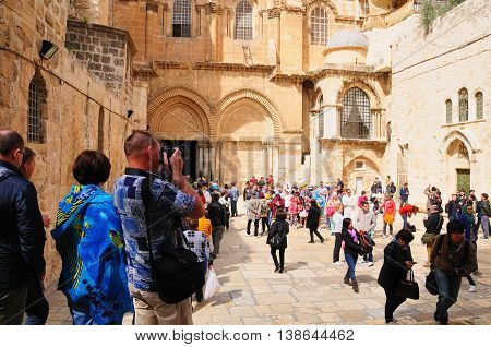 JERUSALEM, ISRAEL - MARCH 22:   Crowd of tourists on March 22, 2015 at the entrance to the Church of the Holy Sepulchre  in Old Jerusalem city.