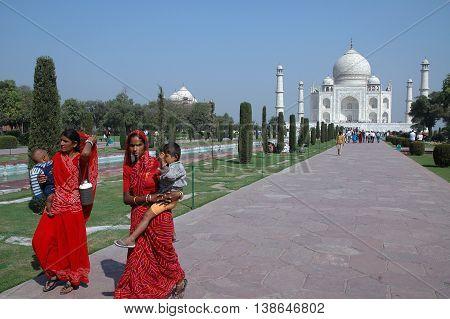 Agra, Utta Pradesh, India - march 07, 2006: Two women with their children walking through the gardens of the Taj Mahal
