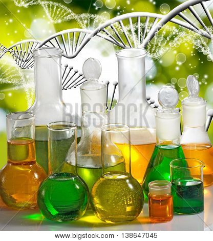 Isolated image of laboratory glassware on the genetic chain background close up