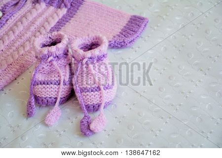 Baby violet booties and part of sweater
