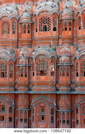 Jaipur, Rajasthan, India - february 23, 2006: A woman and a child, overlook one of the windows of the Hawa Mahal or Palace of the Winds