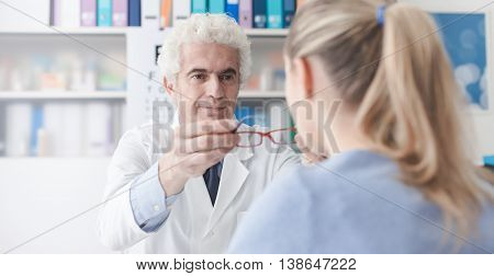 Ophthalmologist Giving Glasses To The Patient