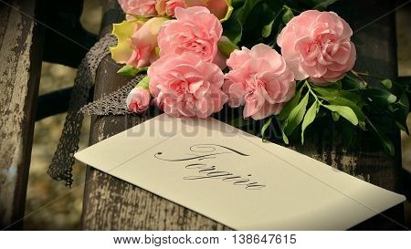 Pink Floral bouquet background and forgive tag/card