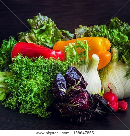 Close up of various colorful raw vegetables. Different raw vegetables background on dark wooden background. Healthy eating. Colorful vegetables background. Healthy food background.