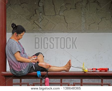 Woman Is Resting In Park Of Chengdu City