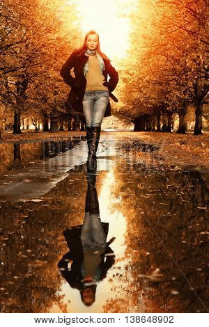 Woman walking in park at autumn