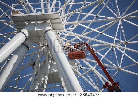 Rostov-on-Don Russia- July 16:Construction of the Ferris wheel 65 meters. The workers while being on a mounting rig collecting wheel