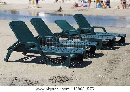 Chaise-longue On The Beach.