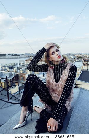 young pretty fashion lady on roof top having fun party time, lifestyle people concept, summer evening