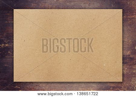 Brown Paper On Wood Background With Space